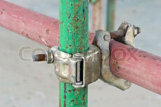 Detail of vintage and rusty scaffolding clamp with pipes | Stock ...