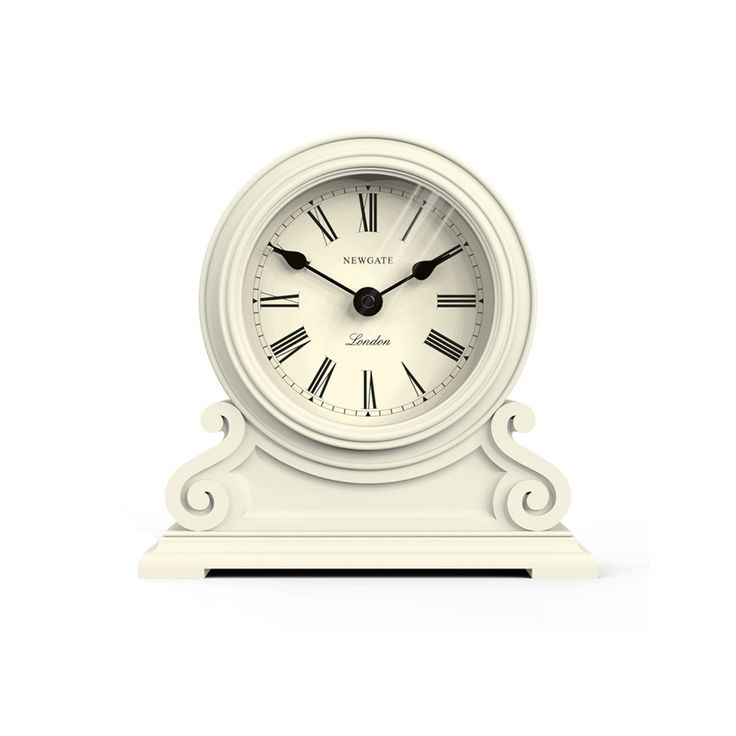 A classic cream mantel clock built to decorate the finest desks and inspire their owners to works of brilliance. The Writing Desk's moulded barrel case is set on a decorative plinth and supported by curlicue scrolls. A Roman dial and traditional spade hands mark time.