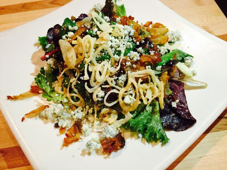 field greens salad with sugar snap peas, shaved fennel, house cured pancetta, crispy shallots, crumbled blue cheese,  spring herb vinaigrette