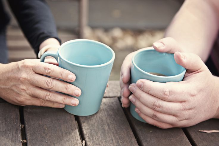 Low res Hands holding blue mugs