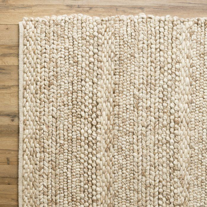 Perfect for country-casual and beach-chic settings, this charming wool rug adds a touch of texture to your master suite or living room.