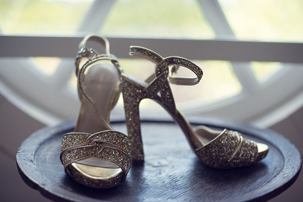 Sparkling gold high heels for a Winter wedding