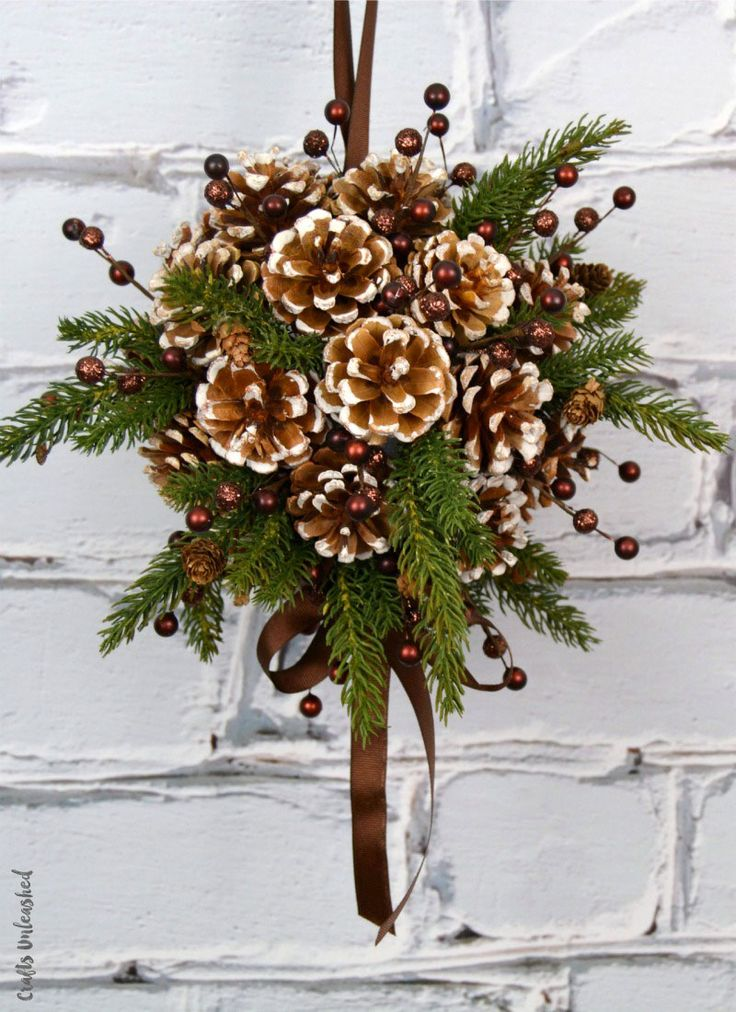 DIY pine cone & evergreen ball is the perfect option to a traditional wreath.