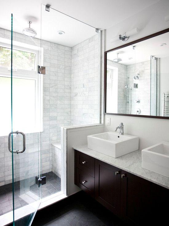 Clean lines--dual vessel sinks, white/grey tile, and dark wood.