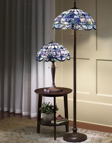 Shades of Beauty Multicolored Stained Glass Floor Lamp from Midnight Velvet. Intricately pieced and beautifully detailed, this elegant Tiffany-style stained glass lamp will lend the glow of sophistication to any room.
