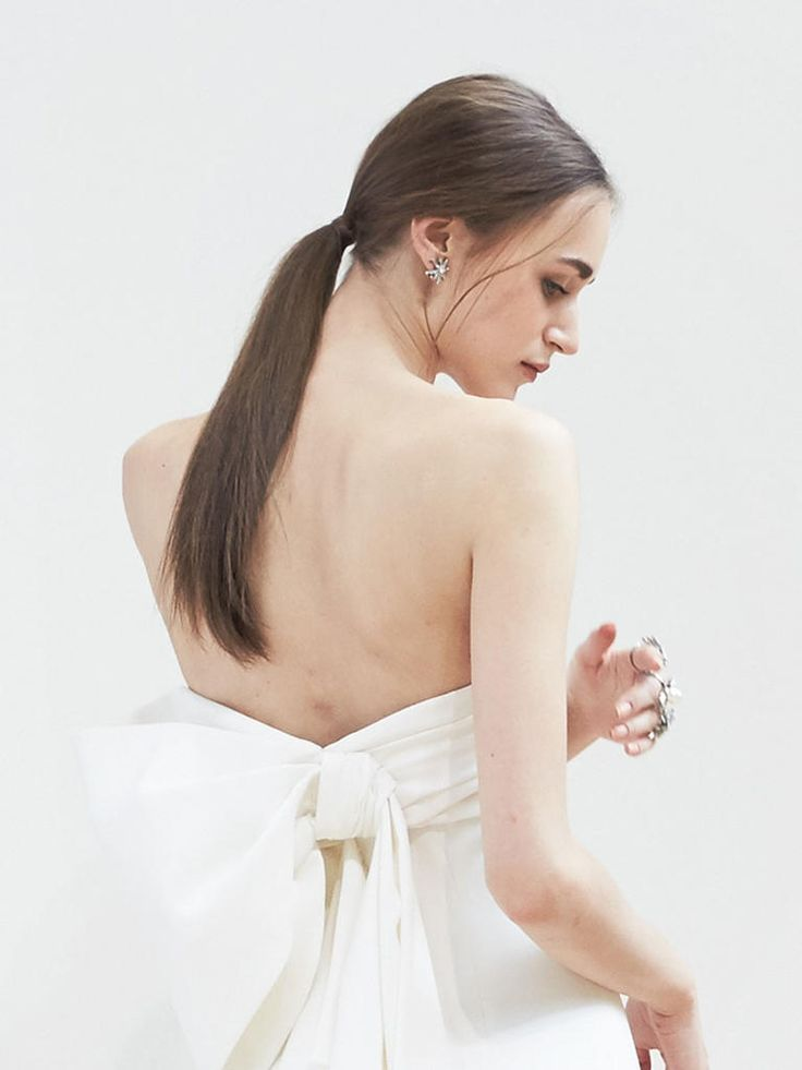 Style a sleek, low ponytail wedding hairstyle for long bridal hair that's totally runway-refined.