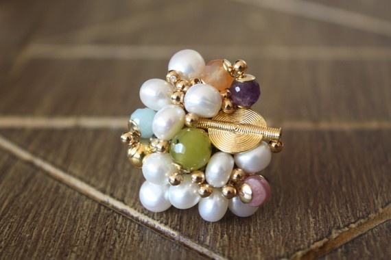 Aflé Bijoux Arlequin Ring. Fresh water pearls, amazonite, green serpetine, amethyst, orange carnelian, rodochrosite, Akan gold weight. #aflebijoux #bijoux #jewelry #etsy