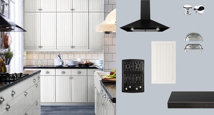 AKURUM kitchen with STÅT white doors/drawers and PRÄGEL black stone effect countertop