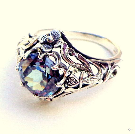 This Beauty is a 2.5ct. Russian lab. created, Faceted Alexandrite, which has been set in a Victorian Style, Sterling Silver, Filigree Ring.