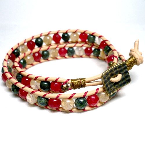 Holiday inspired with a modern twist.  I have modified the popular Chan Luu style bracelet adding a Christmas mix of colored gemstones.  I have used Russian serpentine, latte quartz and ruby quartz.  Each gemstone has been carefully hand sewn onto tan leather cord using bright red C-Lon beading thread.  To finish off the bracelet I used a silk wrapping technique with gold C-Lon beading thread.  The button is an awesome waffle design of hammered antique brass created by TierraCast.  When I…