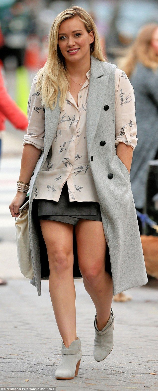 The thigh's the limit! Dressed to impress, the former child star was clearly all grown up as she flaunted her perfect pins in a leather wrap-around skirt