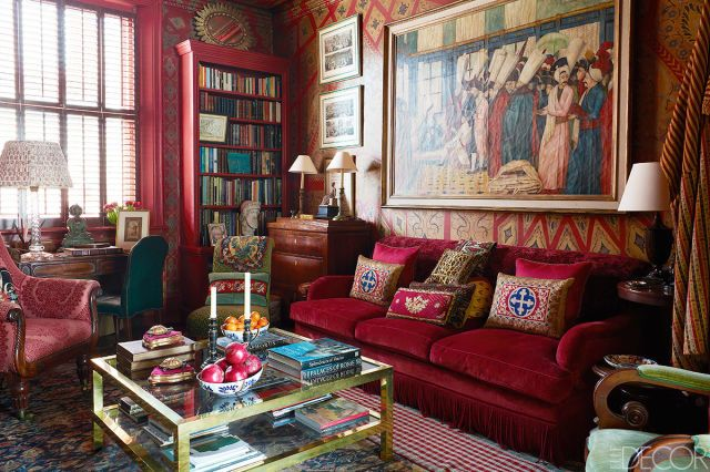 The hand-painted walls of fashion designer Alidad's library are stenciled with an Islamic pattern. The room is embellished with plenty of worldly items, including a Venetian painting from the 17th century. Tour the rest of the home.   - ELLEDecor.com