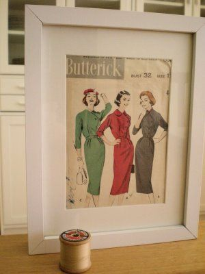 Framed vintage sewing patterns in the sewing room