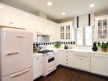 """An L-shape layout is often a smart choice for a smaller kitchen. In this retro-inspired kitchen, shorter """"legs"""" mean less distance between the sink, stove and refrigerator, allowing the space to be used more efficiently."""
