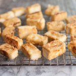 Transfer the browned tofu to a cooling rack while you finish your recipe. Eat the tofu immediately. It will remain crispy for a few hours, but will become chewy and lose its crispness if refrigerated.