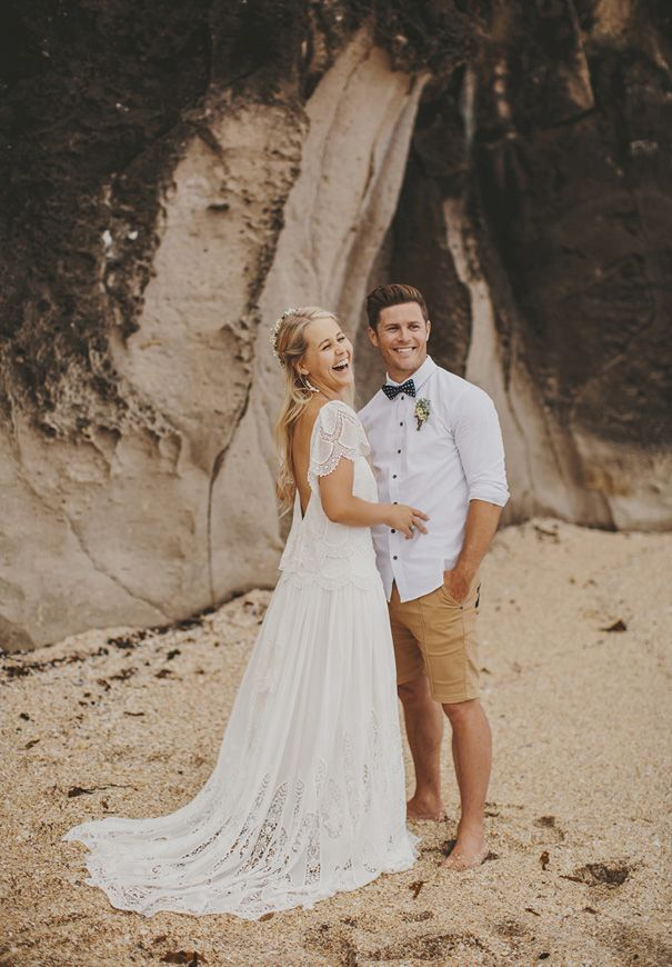 If Boho is your wedding style and getting married at the beach, there are lots of options for fashion.  Shorts for grooms? Why Not! Get more ideas on trending wedding fashions and tips on our June Weddings site. (Image by Hello May)