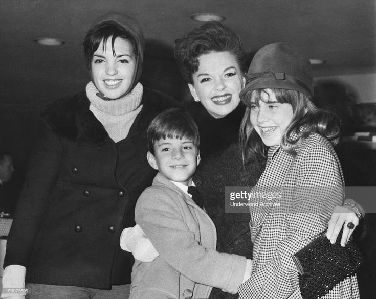 Judy Garland (1922-1969) with all three of her children at JFK Airport, New York, New York, 1964. Left is Liza Minnelli, and Joey and Lorna Luft.
