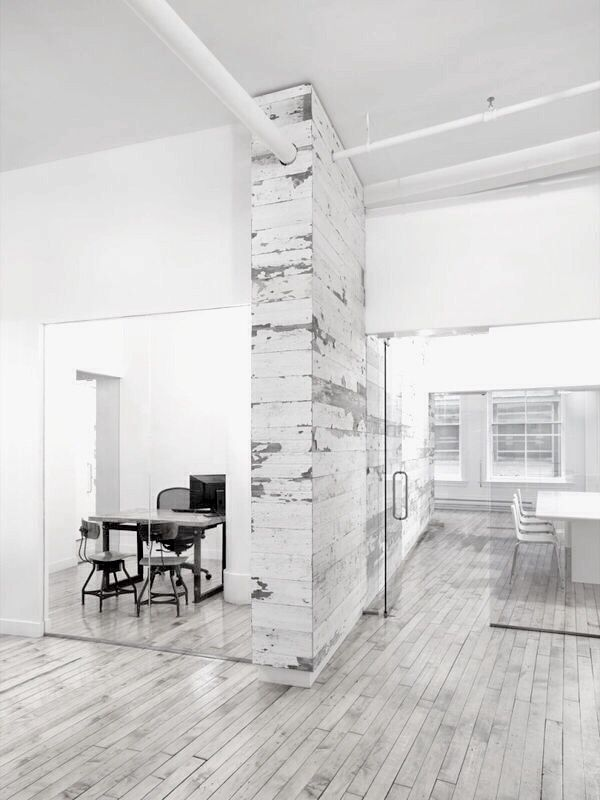 Light narrow, painted wooden floorboards create an illusion of space and light #OfficeFloorInspiration