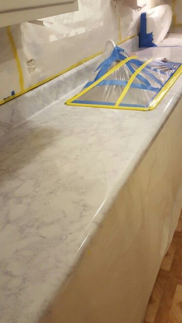 Contact paper on countertop. The trick is to use a spray bottle with soapy water like they do when you get tint on your windows.