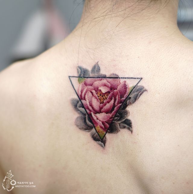 Aro Tattoo exquisitely inks clients with delicate floral designs that completely skip the black ink outlines and define form with color.