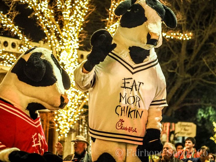 Chick-fil-A cows in the Order of Mystic Magnolias Mardi Gras parade in beautiful downtown Fairhope, Alabama.