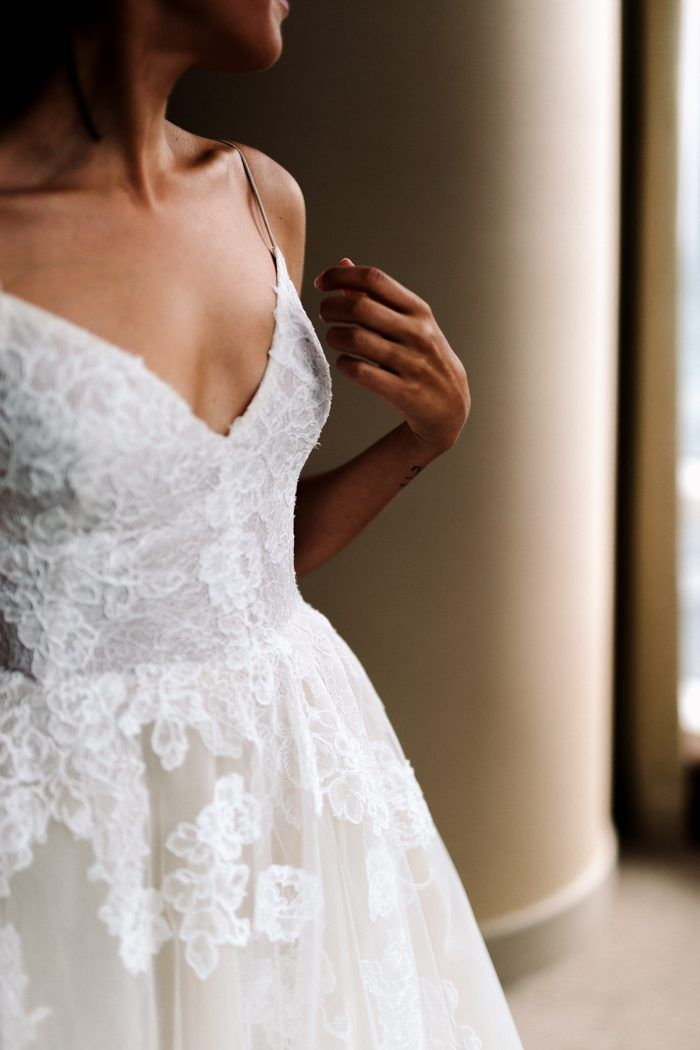 Love this bride's gorgeous blush and lace by Monique Lhuiller casual-contemporary wedding dress | image by Laura Rowe Photography #weddingphotoinspiration #weddingphotoideas #weddingphotoinspiration #weddingdress #bridalportrait #bridalstyle #bridalfashion #bridalinspo #bridalinspiration #bride #bridalhair #bridalhairstyle #bridalmakeup #gettingreadyinspo