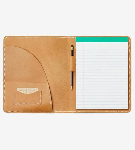Make your brainstorms, interviews and business meetings more stylish with this leather portfolio. It comes equipped with a lined white notepad for your important lists, and a pocket on the left holds loose sheets, envelopes and paperwork. Keep a business card or two in the card slot and a pen in the loop, and you'll be ready for all note-taking occasions.