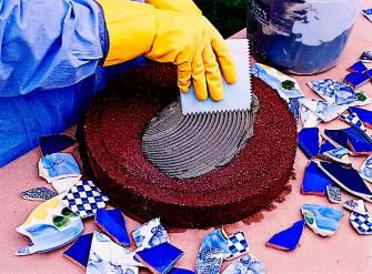 Add color to your landscape with easy-to-make stepping-stones you decorate with mosaics. Use the same technique for other mosaic garden projects.