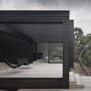 I love the simple, clean lines of this home by Studio Four. The use of black cladding with massive windows creates a striking exterior which creates a open and airy interior which links superbly with the world outside. The simplicity continues inside with clean spaces and simple lines which is supplemented by the monotone furnishing.
