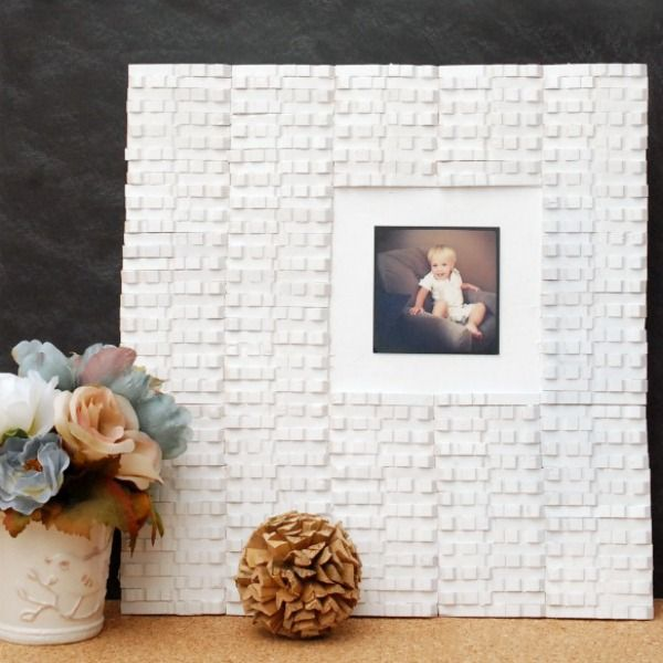 Make this cool picture frame with an old cabinet door and some clothespins from…