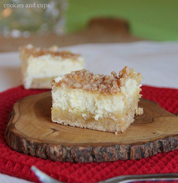 Sugar Cookie Cheescake Bars  1 (17.5 oz) pouch sugar cookie mix  1 (4 serving size) box French Vanilla Instant Pudding  2 Tbsp packed light brown sugar  1/2 cup butter, melted (1 stick)  3 tsp vanilla  2 whole eggs + 3 egg yolks  2 (8 oz) packages cream cheese, room temperature  1/2 cup sour cream  1/2 cup granulated sugar  *optional ~ 2/3 cup toffee bits, pulverized in blender or food processor