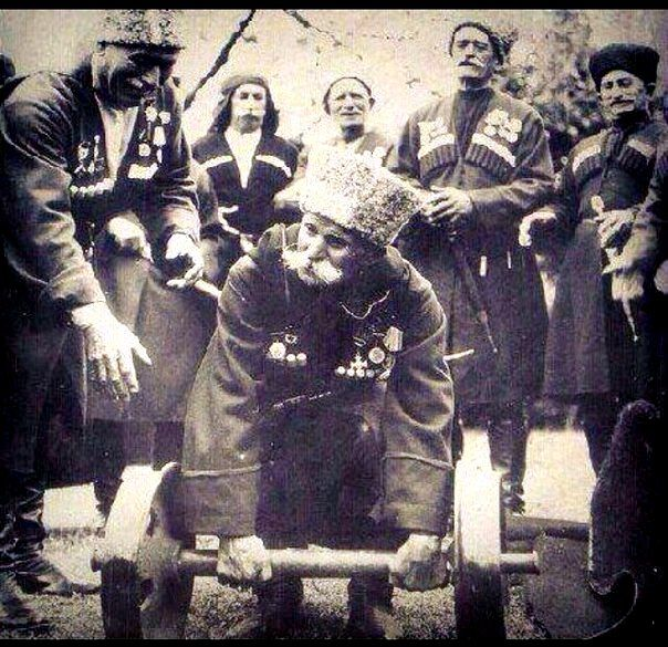 A group of singers (supposedly over 100 years old) called 'The Narts' showing off their strength.