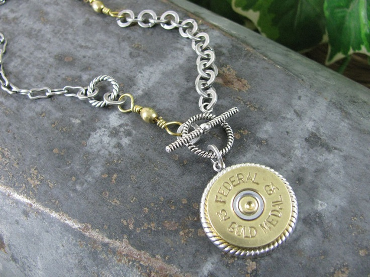 Shotgun Casing Jewelry - Bullet Casing Jewelry - Authentic Federal Gold Medal 12 Gauge Shotgun Shell Medallion Mixed Metal Necklace. $42.50, via Etsy.