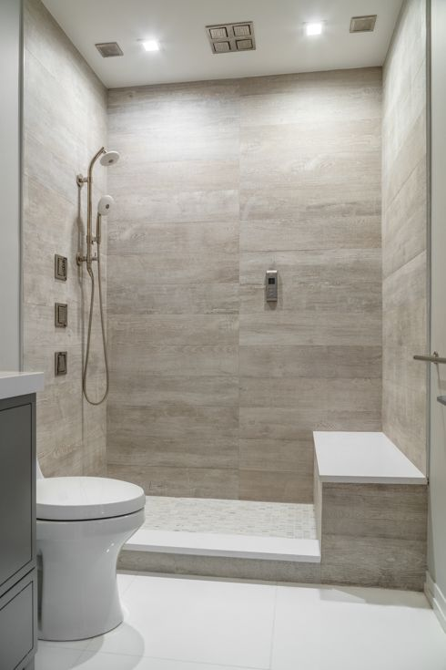 Artistic Tile I Traditional Home's Hamptons Designer Showhouse 2016 I Our  Bosco White planks in the last shower offer a zen wood-look that is  otherwise hard ...