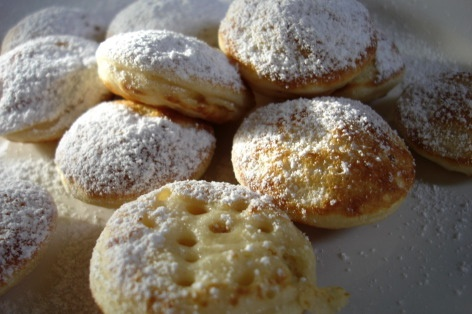 """Typical Dutch treat called """"poffertjes"""". There best compared with tiny, tiny pancakes and you eat them with butter and powdered sugar. Kids love them."""