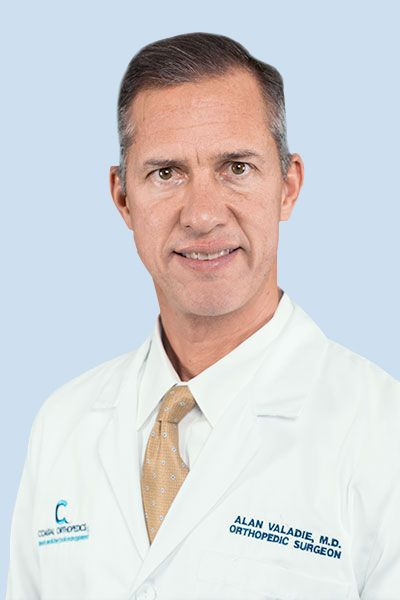 Dr. Alan Valadie is a board certified orthopedic surgeon who specializes in adult hip and knee reconstruction including primary and revision hip and knee replacement, as well as partial knee resurfacing. Dr. Valadie performs outpatient knee replacement and total hip replacement surgeries, pioneering this procedure in the state of Florida.