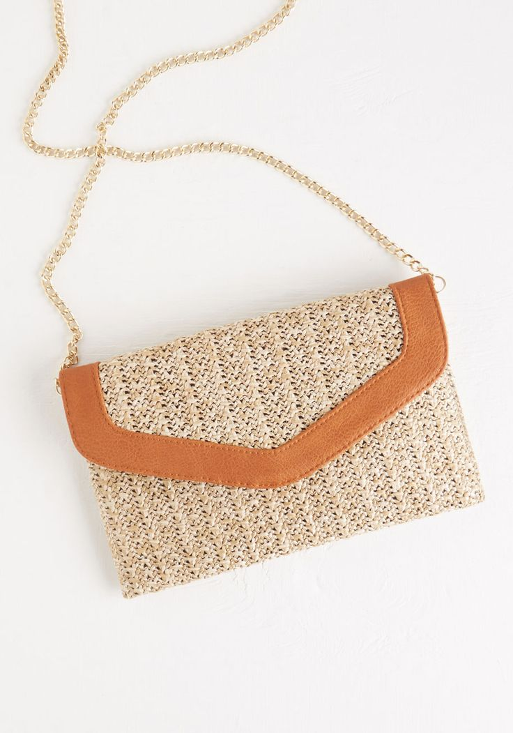 At All Coasts Bag. Whether youre relaxing lakeside, picnicking by the pond, or strolling the boardwalk, this woven bag will see that you do so in sunny style!  #modcloth