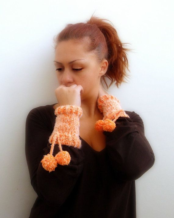 Orange arm warmers with cord and two pompoms handmade by Kikoa, $38.00