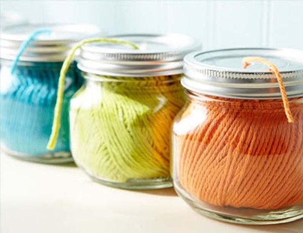 Use small mason jars for string and yarn to keep them rolled up. Just puncture a hole in the top and thread it through before securing the lid.