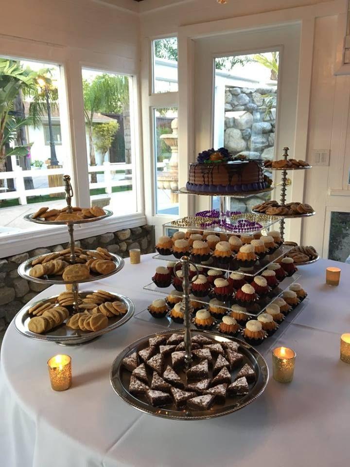 Dessert Table for Birthday Party at Rancho de las Palmas #birthday #birthdayparty #mardigras #masqueradeparty #desserts #cookies #chocolatechipcookies #sugarcookies #fudgebrownies #cake #birthdaycake #sweet16 #bundtinis #nothingbundtcakes #candlevotives #ranchodelaspalmas