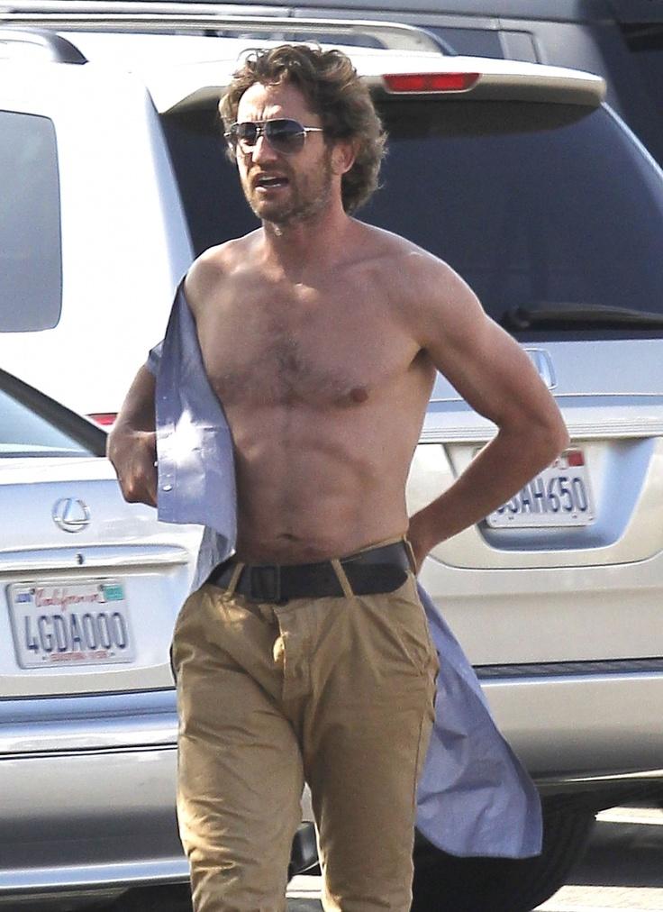 Gerard Butler's Many Shirtless Looks Gerard Butler soaks up the sun in Malibu, Calif. on August 13, 2011.