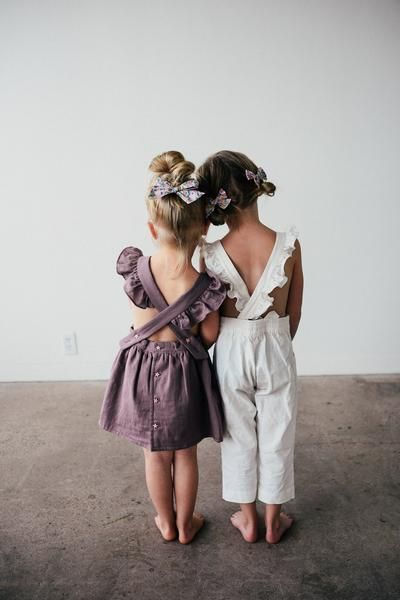 Click to shop these big and mini pinwheel hair bows available in large and mini versions! Perfect for you baby, toddler or little girls free spirit and adventurous style. Handcrafted in the USA and guaranteed for life!! Dress by Blythe and Reese, Romper by Daughter Co.