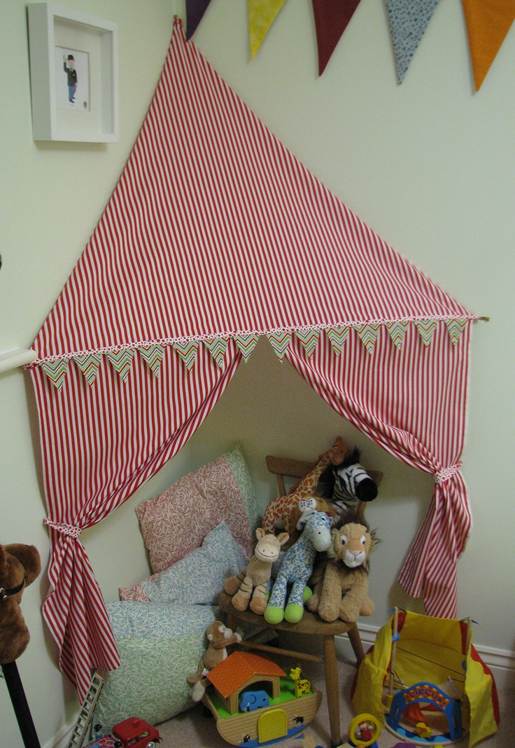 How cute is this! Fabric HQ: Circus Inspired Corner Tent, suitable for small rooms.