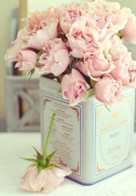 vintage tin can as a vase for blush flowers