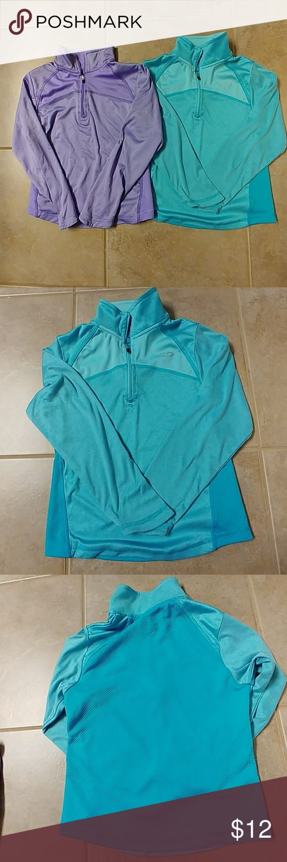 Two Girls' Activewear Tops Great Used Condition. Slight signs of wear from normal use. There are faint snags on the back of both shirts(please see photos). Nothing too noticeable. C9 Quarter Zip Activewear Tops. One is blue and the other is purple. Size Small (6-6x) C9 Shirts & Tops