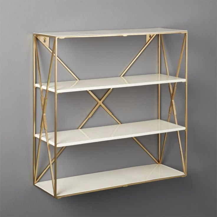 Shop Smith Large Brass Wall Shelf.   Frame stacks two enamel shelves for an open, airy design.  Perfect in the entry, bathroom or kitchen (think wine glasses, spice rack, etc. ).  Layer up for more storage/drama.  Smith Wall Shelves is a CB2 exclusive.