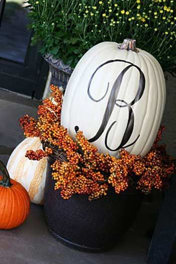 Thankfully, pumpkins are plentiful this time of year (and inexpensive). Make your own budget Thanksgiving decorations by spray painting a pumpkin white and then drawing your monogram with permanent marker.