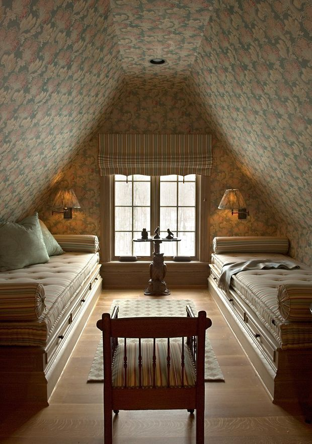 Cozy attic bedroom with upholstered walls and ceiling, sconces, daybeds - Barry Dixon
