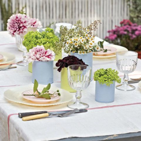 For a casual brunch outdoors, place simple groupings of flowers into coffee and soup cans painted from Benjamin Moore sample jars. Try using moss instead of floral foam. Flowers stay in place, and the moss is reusable.