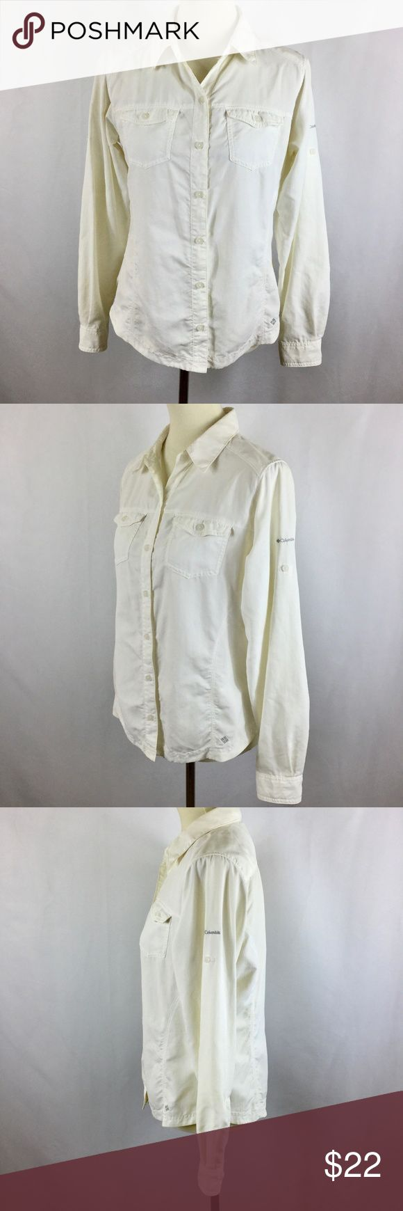 "Columbia Omni-Shade Sun Protection Outdoors Shirt Columbia Omni-Shade shirt in women's medium, off-white color. It has long sleeves with a roll tab so you can roll them up as far as above the elbow, or leave down. 2 breast pockets with button flap closure, and high button on collar lapel for the option to convert to a funnel neck style. Button front, with extra material on the shoulders where protection from the sun is needed most. Lightweight nylon.  Measurements: Bust: 40"", Length: 26""…"